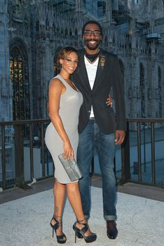Amar'e Stoudemire with his wife. Kinda in love with his medallions
