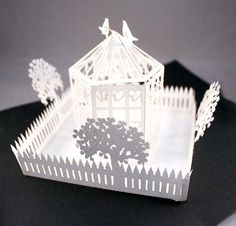 popup card with birdcage and picket fence