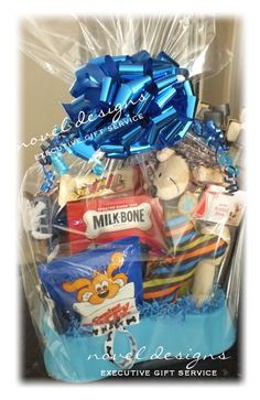 Dog Lover Gift Basket - Bone Shaped Water Dish, Assorted Dog Treats Bones, Plush Toys, Tennis Balls Even Something for the Owner. Easy to Re-Create! For more ideas, follow us VegasGiftBasket on pinterest, twitter, facebook instagram.