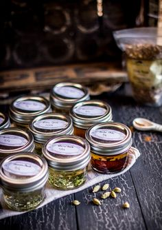 Infused oils, no recipes.love the idea of doing them in the small jars! Flavored Oils, Infused Oils, Spices And Herbs, Fresh Herbs, Homemade Bitters Recipe, Herbal Oil, Perfume, Chutney, Pesto