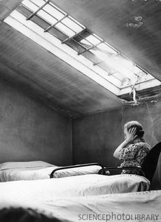 Ohio Insane Asylum, 1946,   Credit: JERRY COOKE/SCIENCE PHOTO LIBRARY    Caption: Woman covering her ears in a room in the Ohio Insane Asylum, 1946.