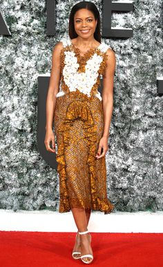 Naomie Harris in a gold and white lace Rodarte midi dress