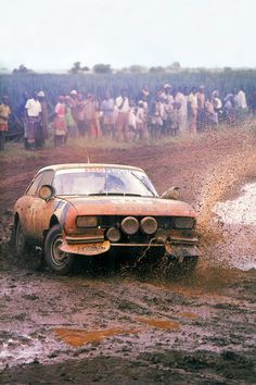 Peugeot 504 Coupe works rally car seen in full action with driver Jean-Pierre Nicolas and co driver Jean-Claude Lefebvre during the extraordinary heavy 1978 edition of the Safari Rally, which they. Peugeot 504, 3008 Peugeot, Race Car Parts, Race Cars, Sports Photos, Car Photos, Course Automobile, Rally Raid, Classic Sports Cars