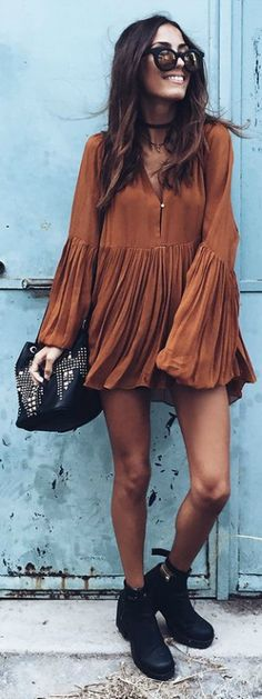 The bell sleeve trend looks even better when it's this cute dress paired with black booties. Via mexiquer Shops: Not Specified