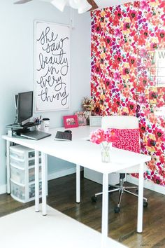One Room Challenge: Office Reveal from Amber Oliver. Bright, color, feminine office / craft room! DIY floral fabric covered wall and DIY acrylic calendar.