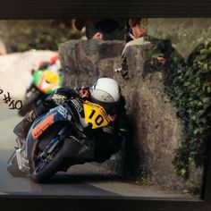 Isle of Man, you would find it hard to believe how fast these guys are moving and almost leaning on the wall...