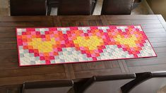 "Fun ""Pixelated Hearts"" table runner by Erica Jackman of Kitchen Table Quilting. I'd love to see this as an entire quilt top!"