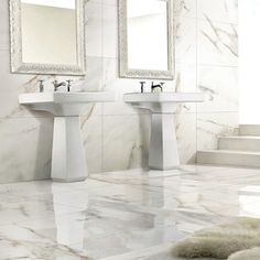 a traditional luxury bathroom featuring white and grey carrara polished marble effect porcelain wall and floor tiles from the porcelthin ferrara tile