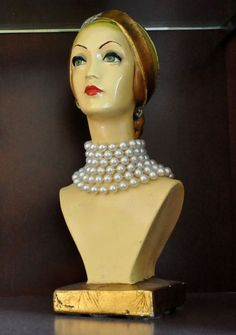love this old store display...bust of lady in pearls...