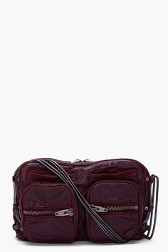 Rectangular textured leather shoulder bag in burgundy. Gunmetal tone hardware. Zip and welt pockets at front. Coil chain shoulder strap threaded through riveted side loops. Zippered shoulder cushion. Single zip compartment with inside zip pocket. Fully lined. Tonal stitching. Approx. 10. 5