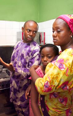 An angry husband scolds his wife and upsets their daughter