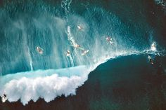 Aerial view of surfers at Sunset Beach in Oahu, Hawaii