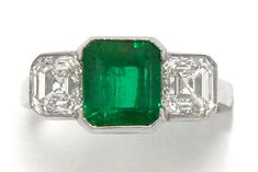 The Palo Alto Colombian emerald 3 stone Art Deco engagement ring. The sleek design starring a natural emerald cut Muzo mine emerald of 2 1/2 carats of an intensely saturated green that glows from within, having excellent clarity, a lustrous tone and graded as insignificant-minor oil is flanked by a pair of GIA certified Asscher cut diamonds. #3stonering #emerald #diamond #engagementring #bellarosagalleries #santabarbara #californiajewelry #love #ido #emeralds #engagementrings #antiquering