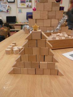 groot bouwwerk namaken met kleine blokjes, de halve zijn een toevoeging van de kinderen.