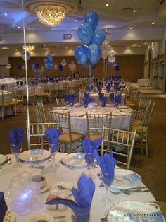 balloon centerpieces tied to a color bag or vase - use different colors mixed together