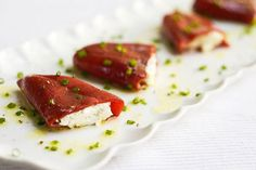 An easy & delicious tapas-style appetizer of softened goat cheese stuffed in tangy piquillo peppers
