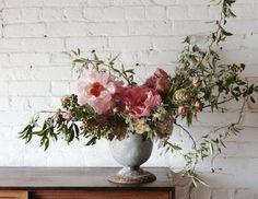 asymetrical floral wedding arrangementFlower School