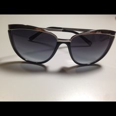 Black cat eye D&G sunglasses Black cat eye D&G sunglasses with silver metal detail. Comes with case and original box. Dolce & Gabbana Accessories Sunglasses