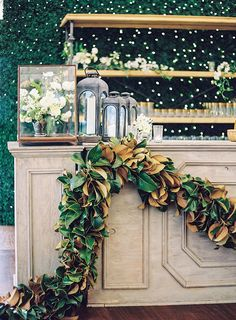 Magnolia Leaf garland, wedding bar decor from The Nouveau Romantics & Tec Petaja.