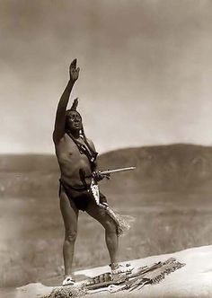Here for your browsing pleasure is a grand photo of an Indian Invocation. It was made in 1907 by Edward S. Curtis.    The photo documents a Dakota Sioux man, wearing breechcloth, holding a pipe, with right hand raised skyward.    We have compiled this collection of photos mainly to serve as a vital educational resource. Contact curator@old-picture.com.    Image ID# 3411C527