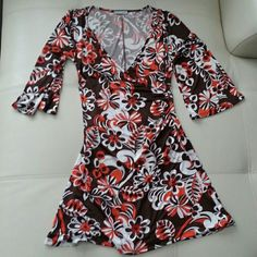 Size small body central dress Brown and orange and ivory print wrap top dress.  ruched waist with panel across abdomen to hold you in Body Central Dresses Mini