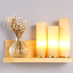 Cylindrical triple wall light with wooden base, nice and beautiful, stands out in any home.