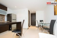Dining room with a 4 person modern dining table. Modern Dining Table, Best Location, Luxury Apartments, Second Floor, Corner Desk, The Good Place, Dining Room, Flooring, Furniture