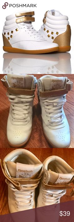 White and bronze REEBOK wedge shoe Used but in great condition. REEBOK Women's wedge shoe with Gold studs detail and Padded ankle for comfort and support. Cushioned inner wedge heel Lace closure. Selling because they're too tight for me. Leather is im great condition. You can swap for new shoe laces under $3.00. Reebok Shoes Sneakers