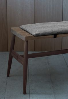 The Imo bench seats 3. Upholstered pad with leather fasteners optional. Dimensions: 1670w x 430d x 430h Finishes: white oiled oak seat and legs or black American walnut legs with oak top.  Fabric: COM or supplied by PINCH