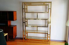 Hollywood Regency Large Scale 6 Shelve Gold Glass Etagere Bianca Style by PopUpModern on Etsy https://www.etsy.com/listing/224058643/hollywood-regency-large-scale-6-shelve