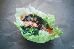 Kimchi Wraps, GreenKitchenStories (recipes provided for components: kimchi, pickled cucumber salad, sesame marinated spinach, coconut ginger mushrooms, vermicelli, lettuce leaves, gochunjang sauce, fermented veg of choice, cilantro)