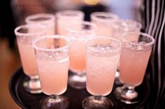 Blushing bride: (passion-fruit nectar, champagne, grenadine) Such a wonderful drink idea. While getting ready on the wedding day, or a wedding shower cocktail!