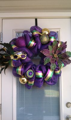 Love it -- but it needs beads.   Mesh Deco Mardi Gras Wreath by SouthernWreathDesign on Etsy, $85.00