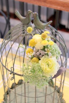 Bird Cage Flowers:  White Waxflower, Queen Anne's Lace, Billy Balls, Yellow Feverfew, Silver Brunia Berries, and Yellow Ranunculus