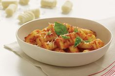 Potato Gnocchi. The secret to fluffy, tender gnocchi is to make the dough while the mashed potatoes are hot.