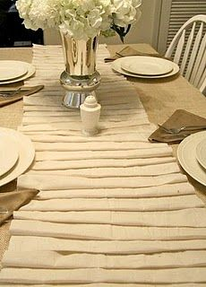 pretty white table decor...pretty white ruffle table runner...