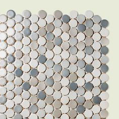 "From: WaterWorks    Try it: If you're worried about keeping a mudroom or foyer floor clean. These soft-gray and taupe ⅞-inch rounds will hide dirt.    Made of: Glazed porcelain    Cost: About $19 per 12"" x 12⅝"" sheet; waterworks.com for stores"