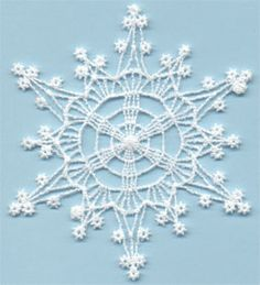 Snowflake 15 - free standing lace machine embroidery, designed to look like crochet; looks better with heavier thread or 2 threads through the needle