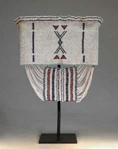Large headbands were worn by young men of the Fingo and Xhosa groups living around East London, South Africa.