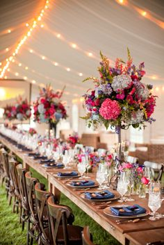 Long table featuring fuchsia and navy tall arrangements. Holly Chapple Flowers - http://thefullbouquetblog.com/