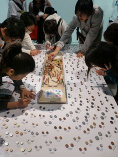 exhibition interactive, carbon copying coins onto paper to take home