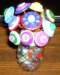 VINTAGE BUTTON BOUQUET IN A SALT SHAKER PINK GREEN RED YELLOW BLUE PURPLE NICE!