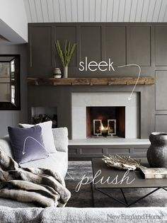 This fireplace looks amazing with a sleek marble surround and a rustic mantel! The dark paint color around the fireplace allows the light colored ...