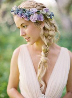 The messy braid is a perfect compliment to the simple grecian dress. Topped off with the perfect halo of delicate florals. Yum!