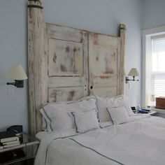 Antique interior doors and exterior house columns come together to make an incredible headboard | CustomMade
