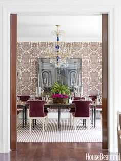 "The dining room of a 1980s house in Fort Wayne, Indiana, was so big, it felt more like a conference room. To ""bring in the scale,"" designer Markham Roberts covered the walls in a bold linen print, Bennison's Lorenzo. Chairs from John Rosselli are covered in Pierre Frey's Mercurio velvet.   - HouseBeautiful.com"