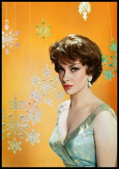 Fabulous Beauty of Gina Lollobrigida wishing us a Merry Christmas just by staring at us!