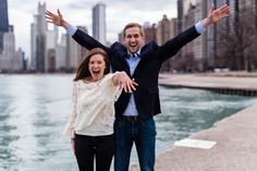 She said yes!! He flew in from San Francisco to surprise her and propose on Chicago's lakefront. Candid proposal photography by Chicago wedding photographer Emma Mullins Photography.