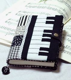 love the piano notes material Music Crafts, Music Decor, Fabric Crafts, Sewing Crafts, Sewing Projects, Fabric Book Covers, Diary Covers, Bible Covers, Fabric Journals
