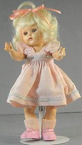 "Hard Plastic Strung Doll Platinum Blond Vintage 8""  http://www.ebay.com/itm/Hard-Plastic-Strung-Doll-Platinum-Blond-Vintage-8-/370600023884?pt=LH_DefaultDomain_0=item56497b974c#ht_3438wt_754"